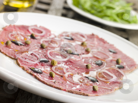 Carpaccio of Beef Fillet with Rocket salad stock photo,  by Monkey Business Images