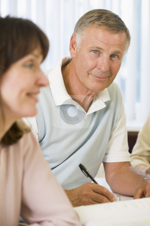 Senior man studying with other adult students stock photo,  by Monkey Business Images
