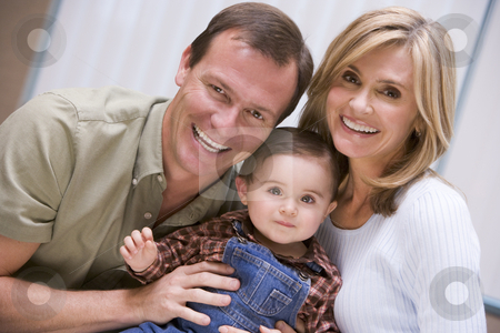 Mother and father with young son stock photo, Mother and father with young son at home by Monkey Business Images
