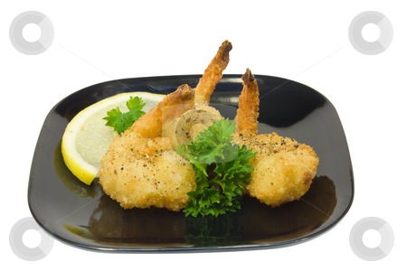 Shrimp appetizer stock photo, Trio of fried shrimp with parsley on a black plate by Lee Barnwell