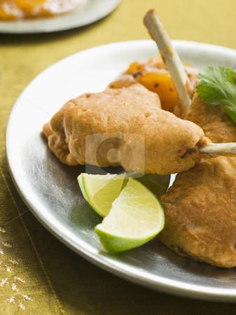 Kashmiri Lamb Cutlets with Lime Wedges and Mango Chutney stock photo,  by Monkey Business Images