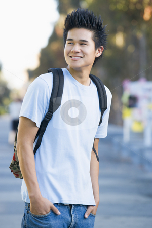 University student wearing rucksack stock photo, Male student wearing rucksack off campus by Monkey Business Images