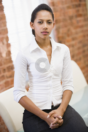 Businesswoman sitting in office space stock photo,  by Monkey Business Images