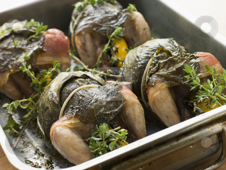 Quails Roasted in Vine Leaves with Lemon and Thyme stock photo,  by Monkey Business Images