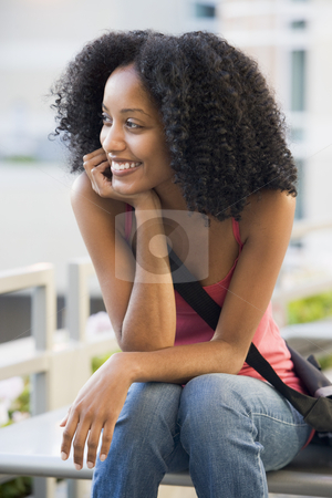 Female student sitting outside stock photo, Female university student sitting outside by Monkey Business Images