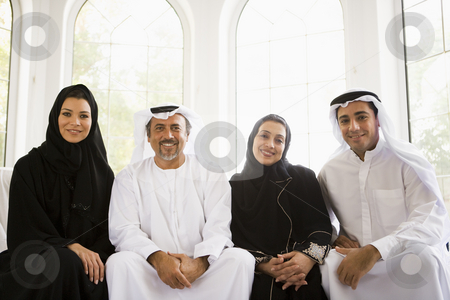 Portrait of a Middle Eastern family sitting together stock photo,  by Monkey Business Images