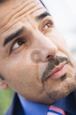 Close-up of businessman stock photo, Close-up of businessman looking off camera by Monkey Business Images