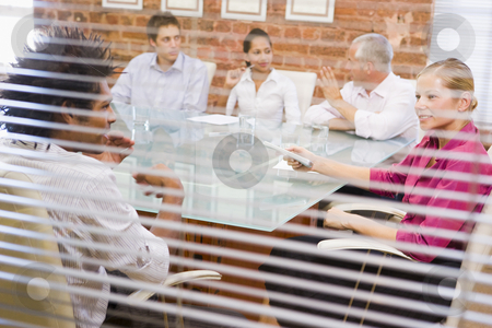 Five businesspeople in boardroom through window stock photo,  by Monkey Business Images
