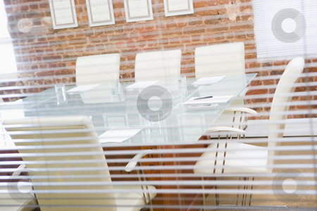 Empty boardroom through a window stock photo,  by Monkey Business Images
