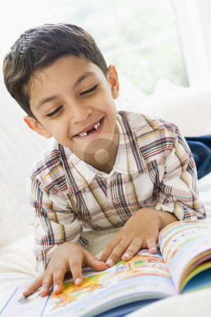 A Middle Eastern boy reading a book stock photo,  by Monkey Business Images