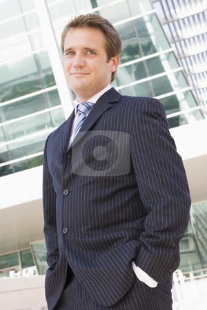 Businessman standing outdoors stock photo,  by Monkey Business Images