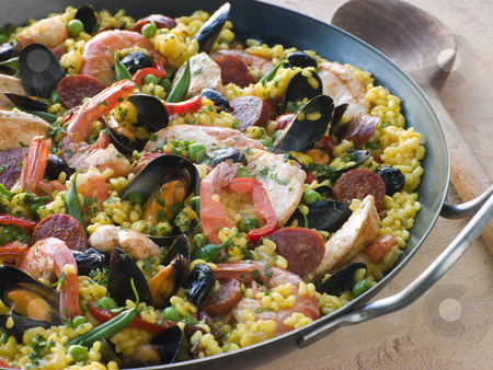 Valencian Paella in a Paella Pan stock photo,  by Monkey Business Images
