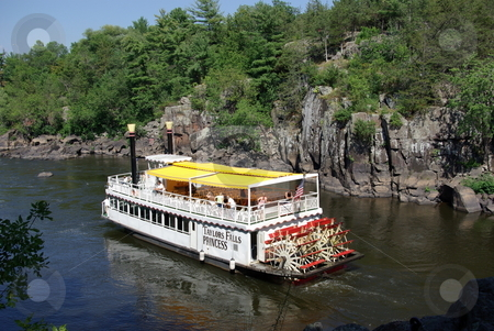 St. Croix River paddleboat stock photo, A favorite summer daytrip travel destination for people living in the Minneapolis - St. Paul metropolitan area is the town of Taylor Falls on the Minnesota border with Wisconsin.  Travelers enjoy a paddleboat aboard the Taylor Falls Princess viewing the rocky cliffs of the St. Croix River as well as rock climbing and hiking in Taylor Falls State Park. by Dennis Thomsen