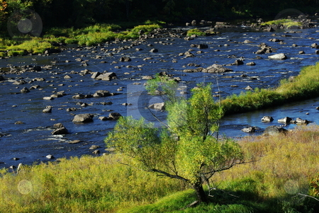 Deep blue river stock photo, A brilliant blue sky on a sunny September day gives the scenic St. Louis River a clean fresh look.   The St. Louis River, which empties into Lake Superior near Duluth, is the major tributory feeding Lake Superior and is a popular tourist sight because of its unusual rock outcroppings. by Dennis Thomsen