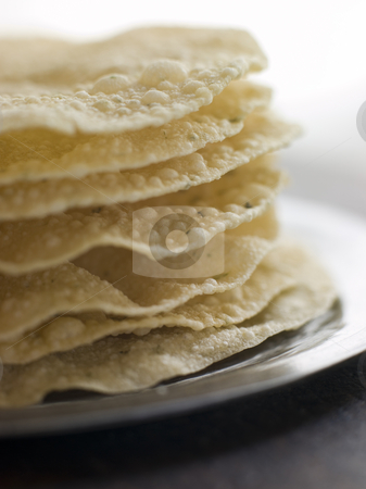 Stack of cooked Papadoms stock photo, Close up of Stack of cooked Papadoms by Monkey Business Images