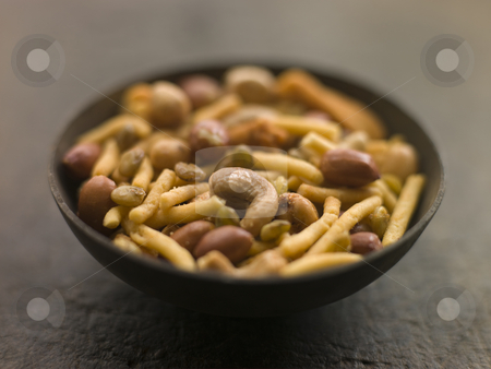 Dish of Bombay Mix stock photo, Close up of dish of bombay mix by Monkey Business Images