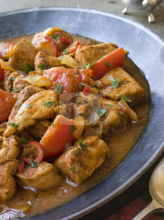 Chicken Bhoona in a Pewter dish stock photo, Chicken Bhoona in a Pewter dish with serving spoon by Monkey Business Images