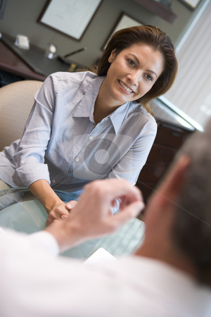 Woman in consultation at IVF clinic stock photo, Woman in consultation at IVF clinic talking to doctor by Monkey Business Images