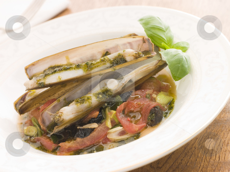 Razor Clams with Stewed Tomatoes Garlic and Olives stock photo, Plate of Razor Clams with Stewed Tomatoes Garlic and Olives by Monkey Business Images