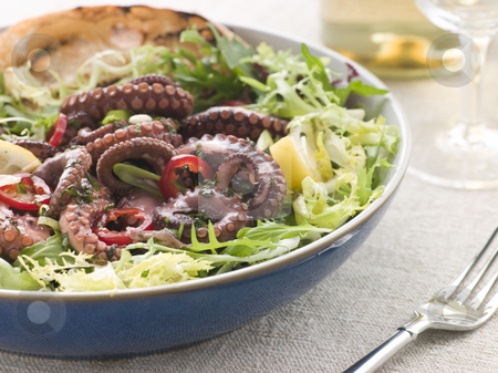 Baby Octopus Salad with Frisse Roquette and Chargrilled Bread stock photo, Bowl of Baby Octopus Salad with Frisse Roquette and Chargrilled Bread by Monkey Business Images