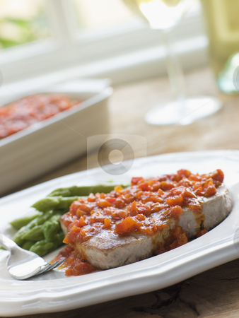 Marmitako Tuna Steak with Asparagus stock photo,  by Monkey Business Images