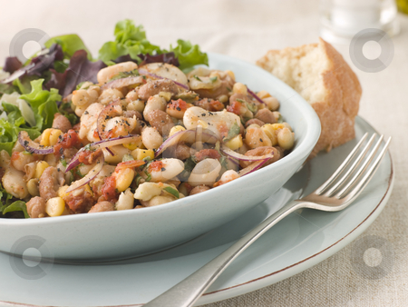 Tuscan Bean Salad with Dressed Leaves and Crusty Bread stock photo, Bowl of Tuscan Bean Salad with Dressed Leaves and Crusty Bread by Monkey Business Images