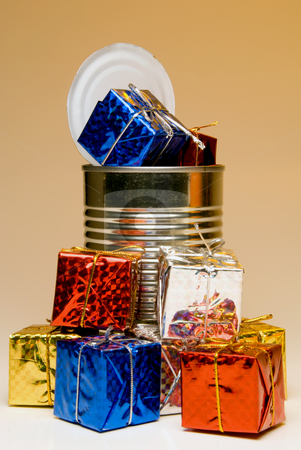 Can-O-Presents stock photo, A tin can overflowing with Christmas presents. by Robert Byron