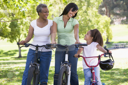 Grandmother mother and granddaughter bike riding stock photo,  by Monkey Business Images