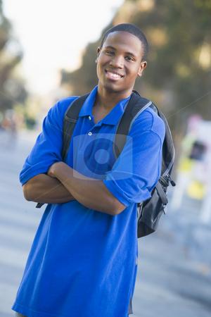 University student wearing rucksack stock photo, Male student wearing rucksack off campus by Monkey Business Images