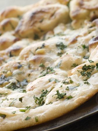 Garlic and Coriander Naan Bread stock photo, Plate of Garlic and Coriander Naan Bread by Monkey Business Images
