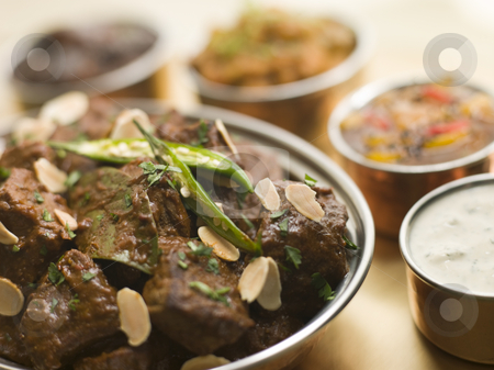 Meat Madras Restaurant Style with Raita and Chutneys stock photo,  by Monkey Business Images