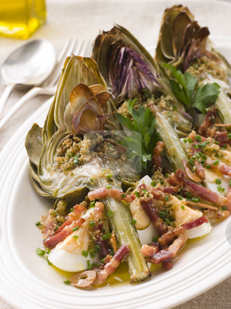 Roasted Globe Artichokes with Pancetta Egg and Garlic Breadcrumb stock photo, Plate of Roasted Globe Artichokes with Pancetta Egg and Garlic Breadcrumbs by Monkey Business Images