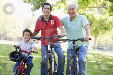 Grandfather son and grandson bike riding stock photo,  by Monkey Business Images