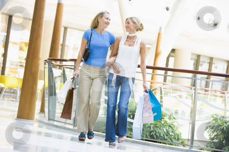 Friends shopping together stock photo, Friends shopping together carrying bags by Monkey Business Images