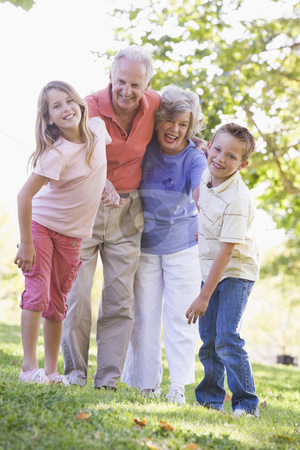 Grandparents laughing with grandchildren stock photo,  by Monkey Business Images
