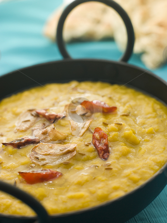 Karai Dish of Tarka Dhal with Naan Bread stock photo, Karai Dish of Tarka Dhal with side of Naan Bread by Monkey Business Images