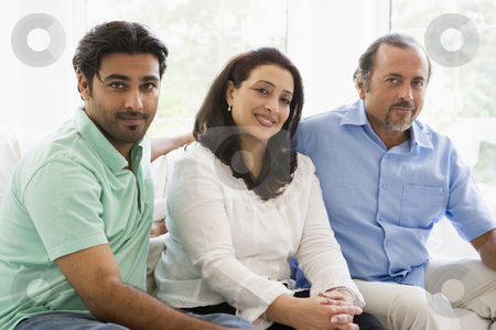 A Middle Eastern couple with their adult son stock photo,  by Monkey Business Images