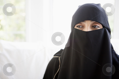 Portrait of a middle eastern woman wearing a black hijab stock photo,  by Monkey Business Images