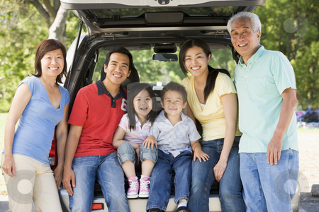 Extended family sitting in tailgate of car stock photo,  by Monkey Business Images