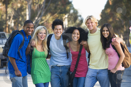 Group of young friends having fun stock photo, Group of six young firneds having fun outside by Monkey Business Images