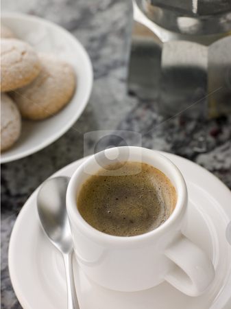 Cup of Espresso Coffee with Amaretti Biscuit stock photo,  by Monkey Business Images