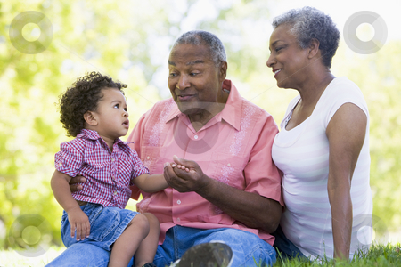 Grandparents with grandson in park stock photo,  by Monkey Business Images