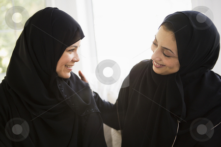 Two Middle Eastern women talking together stock photo,  by Monkey Business Images