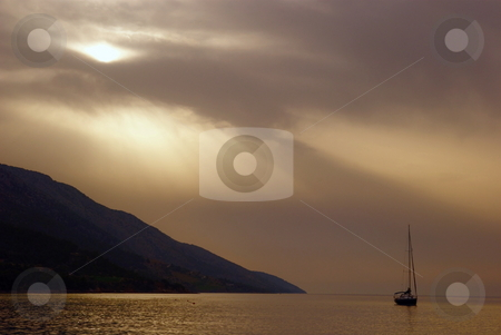 Seascape stock photo, Dramatically beautiful landscape with sea, ship and sun covered with clouds by Milsi Art