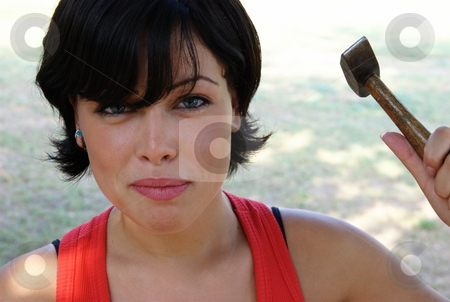 Angry lady stock photo, Angry lady ready to hit with a hammer - fun concept by Milsi Art