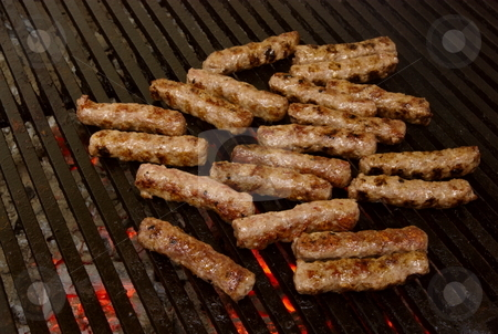 Cevapcici stock photo, Cevapcici - a sort of rolled minced beef, pork and lamb meat preparing on grill similar to Turkish kebab. by Milsi Art