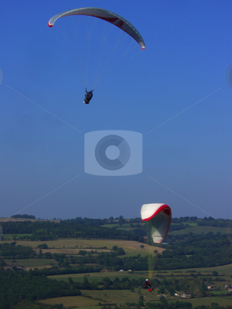Paragliders stock photo, Paragliding over the french countryside in summer by Midas Mould