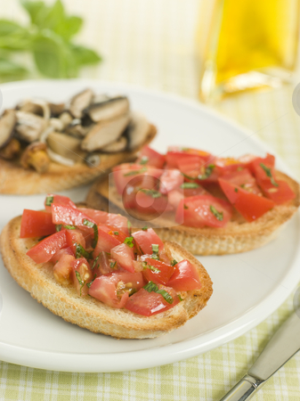 Plate of Vegetarian Bruschetta stock photo,  by Monkey Business Images