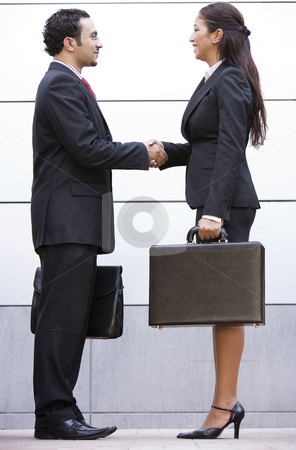 Business meeting outside office stock photo, Business meeting outside modern office by Monkey Business Images