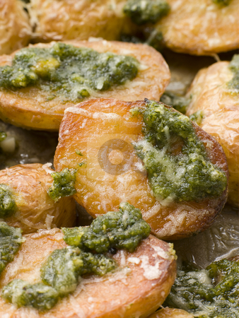 Baby Potatoes roasted with Pesto stock photo, Close up of Baby Potatoes roasted with Pesto by Monkey Business Images